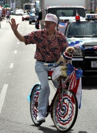 Charlie Hooten and his dog Honey rode along during the 12th Annual Westside Indpendence Day Parade Saturday.
